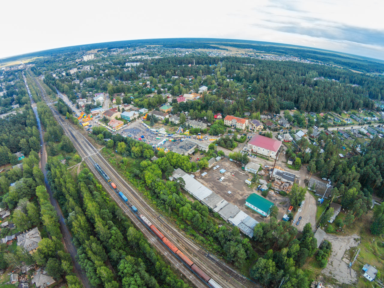 The railway passes through the provincial town. A Bird's Eye View Aerial Aerial View Building Exterior City City Life Cityscape Day Dji Dji Phantom Drone  Dronephotography High Angle View Landscape Maksatiha No People Outdoors Railway Road Scenics Sky Top Perspective Travel Destinations Urban Skyline
