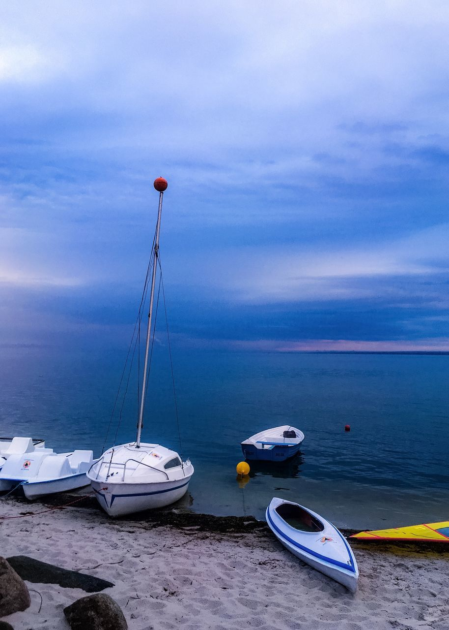 water, sea, nautical vessel, horizon over water, nature, sky, transportation, mode of transport, scenics, boat, no people, beauty in nature, tranquil scene, tranquility, cloud - sky, outdoors, beach, day, moored, sand
