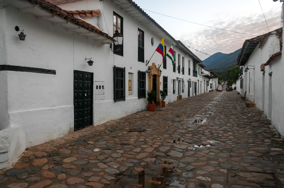 Cobblestone street and old white colonial buildings in Villa de Leyva, Colombia Architecture Building Colombia Colonial Different Exterior Green Historic Home House Latin Old Outdoors Residence Size Stone Style Town Travel Typical Villa De Leyva  Wall Window Windows Wood