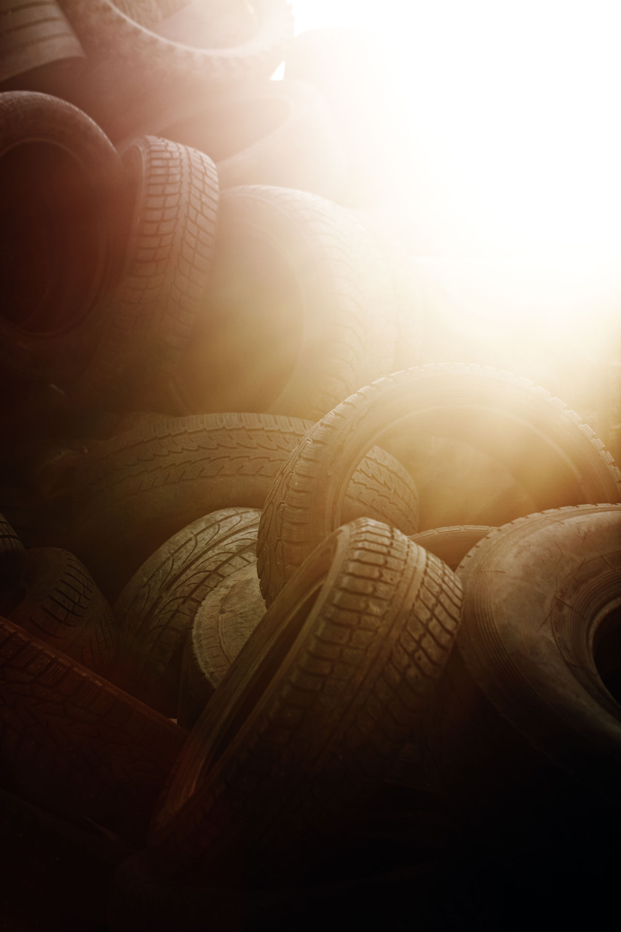 Used car tyres. Car Discarded Junk Light Nobody Objects Obsolete Old Rubber Sun Sunlight Tire Tires Transportation Tyre Tyres