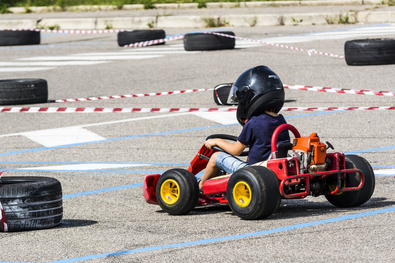 portrait of a go kart at a public event held in a parking lot Auto Racing Competition Crash Helmet Day Driving First Place  Formula One Racing Headwear Helmet Motor Racing Track Motorsport Outdoors People Racecar Speed Sport Sports Helmet Sports Race Sports Track Starting Line Two People