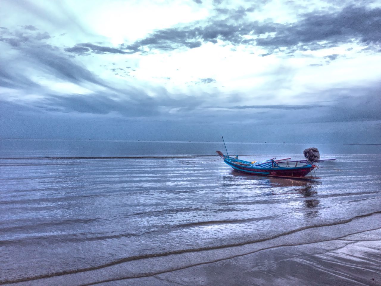 water, sea, cloud - sky, nautical vessel, transportation, nature, sky, mode of transport, waterfront, scenics, beauty in nature, horizon over water, day, outdoors, real people