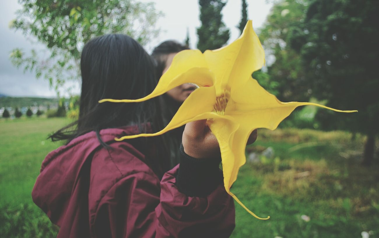 EyeEmNewHere Child Beauty Yellow Flower Nature Tradition Flower Head Outdoors Grace Fragility Adult People Beauty In Nature Close-up Day Beauty Flowers Yelow Flowers Girl With Flower EyemIndonesia WeekOnEyeEm Week On Eyem Eyemphotography Undergraph Photography