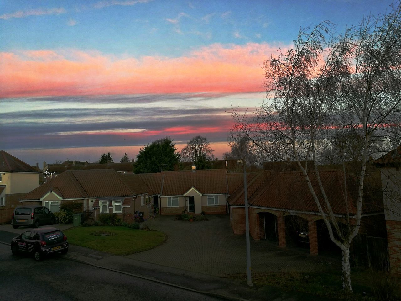 built structure, building exterior, sky, architecture, house, tree, cloud - sky, no people, outdoors, sunset, car, residential building, nature, day, beauty in nature