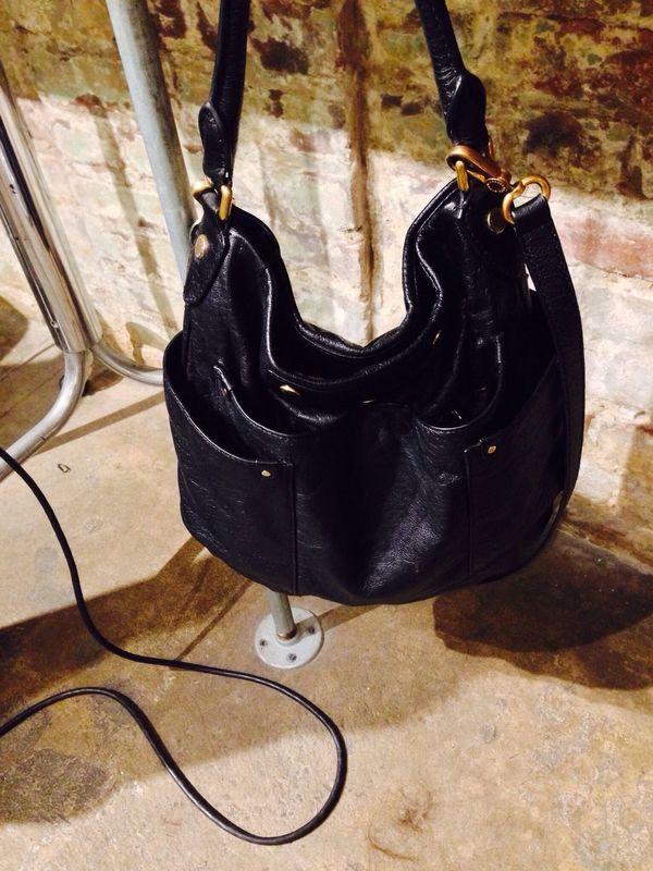 Brick Wall Handbag  At The Salon Taking Photos