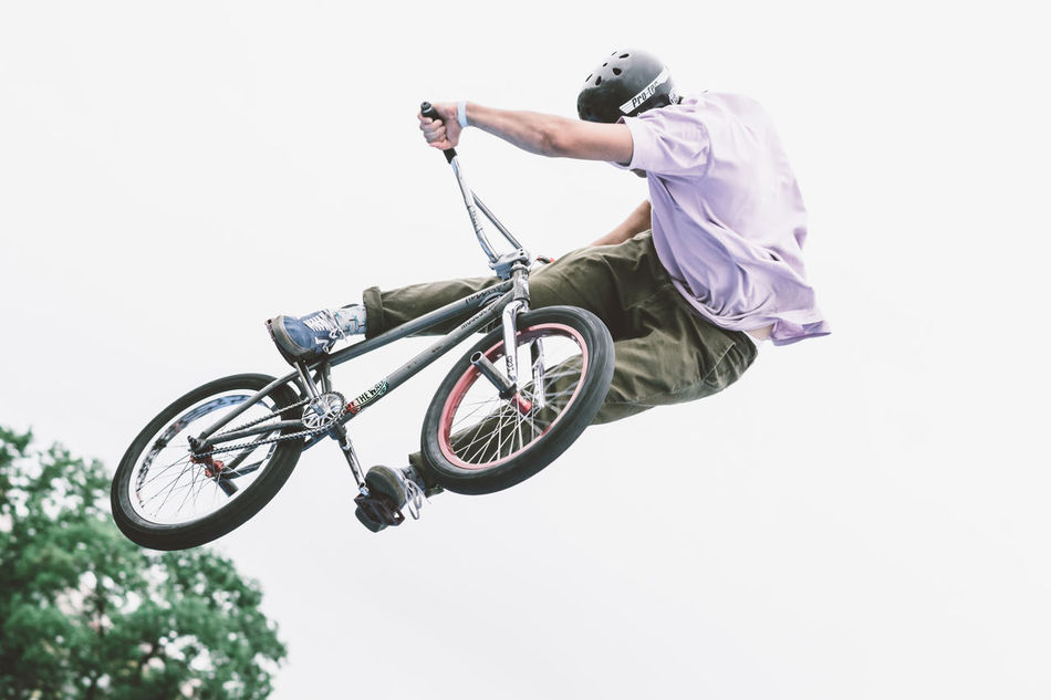 Beautiful stock photos of fahrrad, low angle view, one person, real people, sport