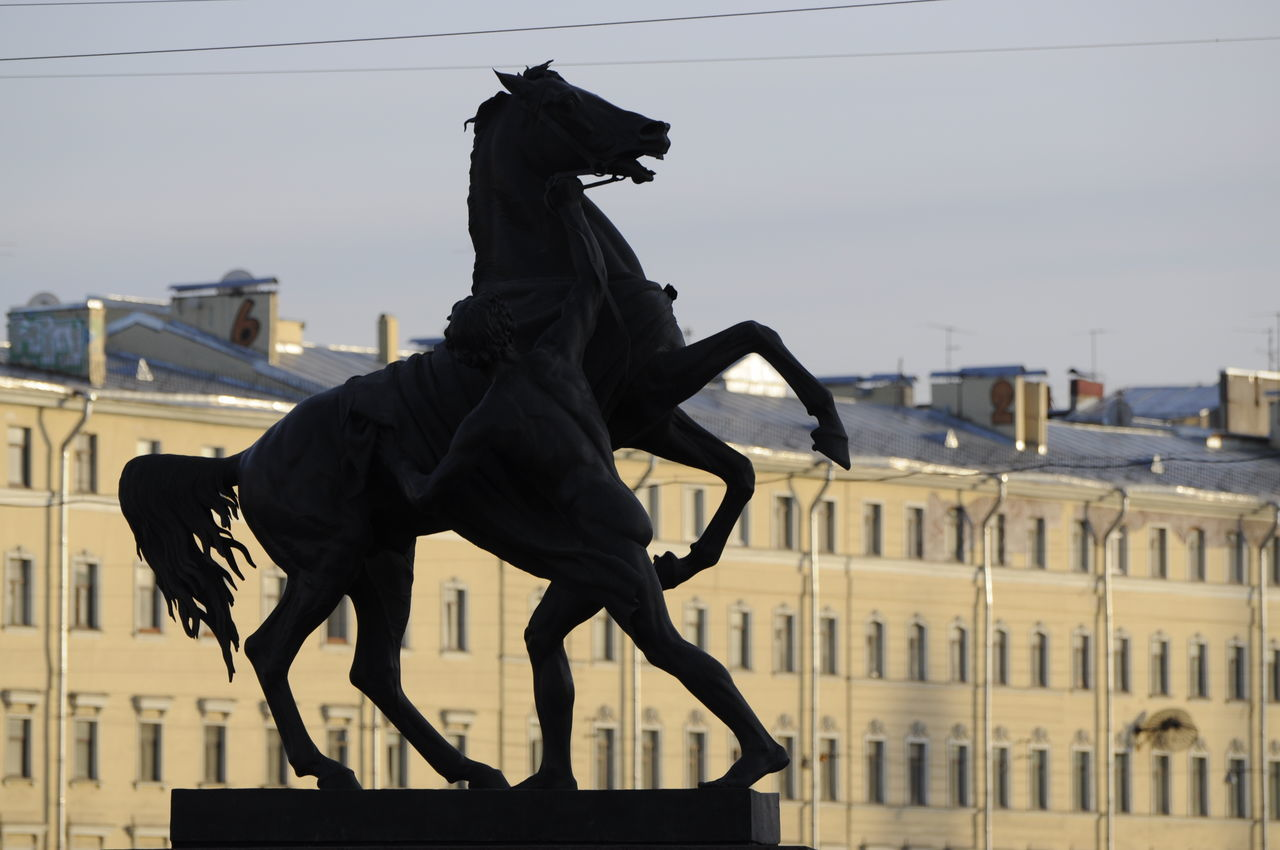 Anichkov Bridge Sculptures - Horse Tamers Anichkov Bridge Anichkov Bridge Sculptures Animal Representation Architecture Bronze - Alloy Building Exterior Built Structure City Cityscape Day Horse Horses Monument Nevskiy Prospekt Nevskyprospekt No People Outdoors Russia Saint Petersburg Sculpture Sky Statue Sunny Sunshine Travel Destinations