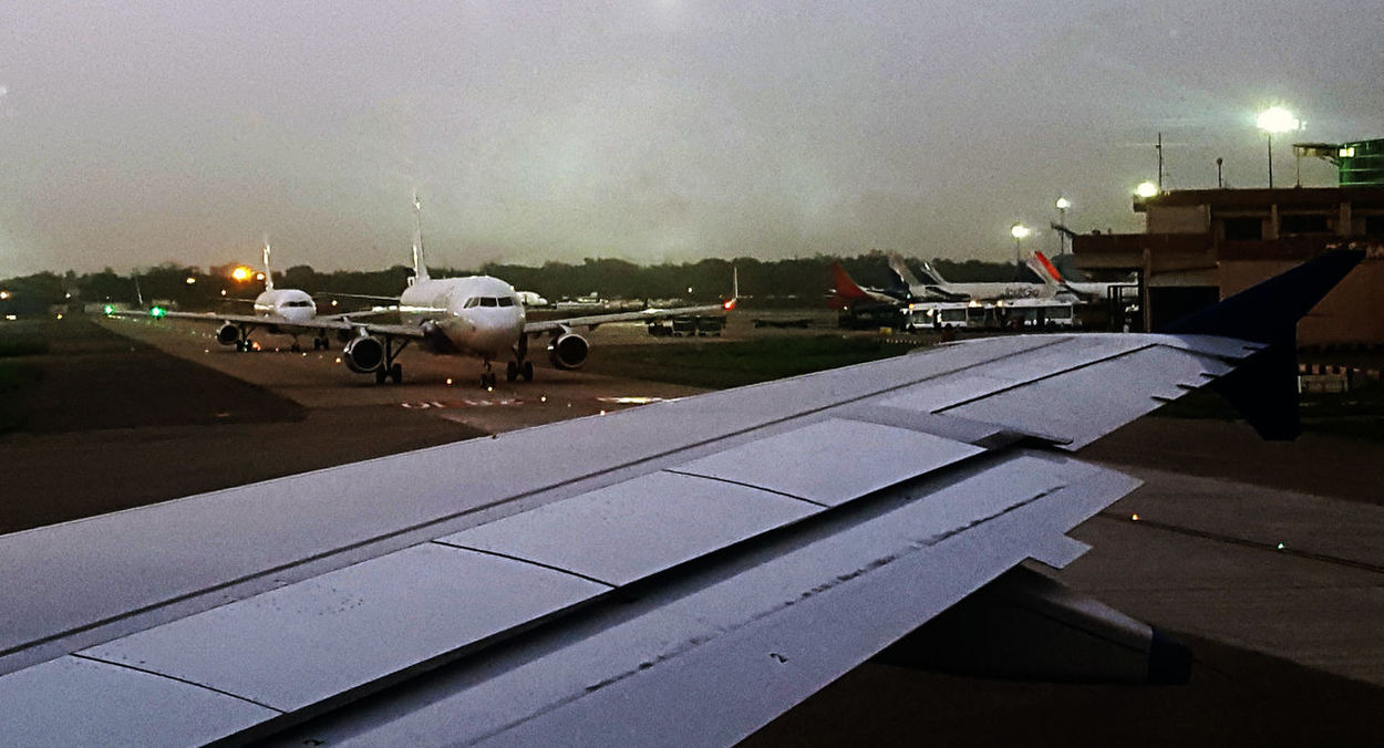 Airplane Airport Runway Transportation Air Vehicle Airport No People Outdoors Aircrafts Aligned Light Indigo Airlines Above The Wing Aircraft Wing