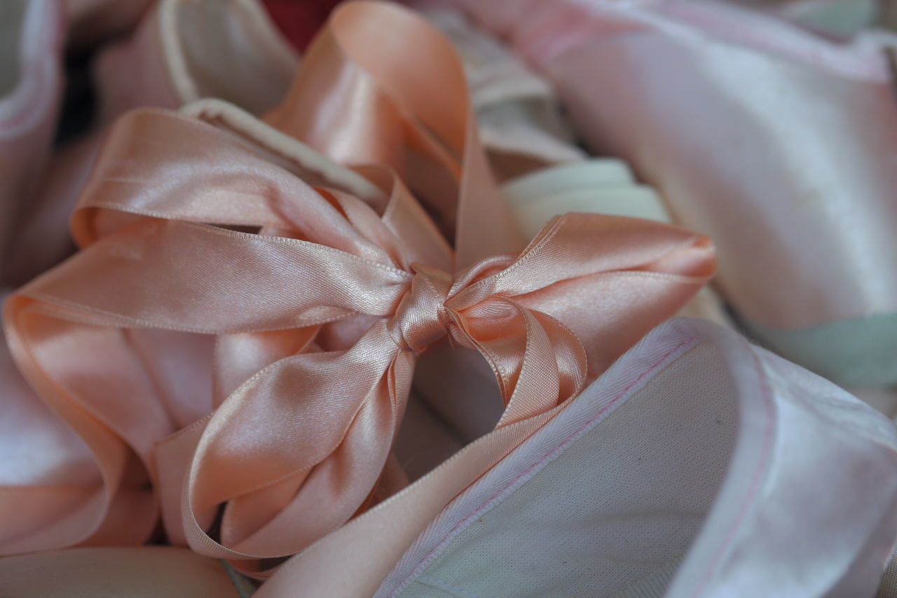 Pink ribbon and child's ballet shoes. Ballet Ballet Shoes Ballet Time  Ballett Bow Childhood Close-up Cute Decoration Delicate Detail Eye4photography  EyeEm Best Shots EyeEm Gallery Gift Hello World Macro Maximum Closeness Pink Pink Ribbon Ribbon Shoes Shop Window Still Life Tied Bow