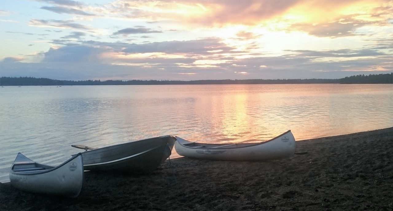 Beach Beauty In Nature Canoe Canoes Close-up Cloud - Sky Day Kayak Lake Nature Nautical Vessel No People Outdoor Pursuit Outdoors Reflection Rowboat Sky Sunset Swedish Lake Tranquil Scene Tranquility Vacations Water