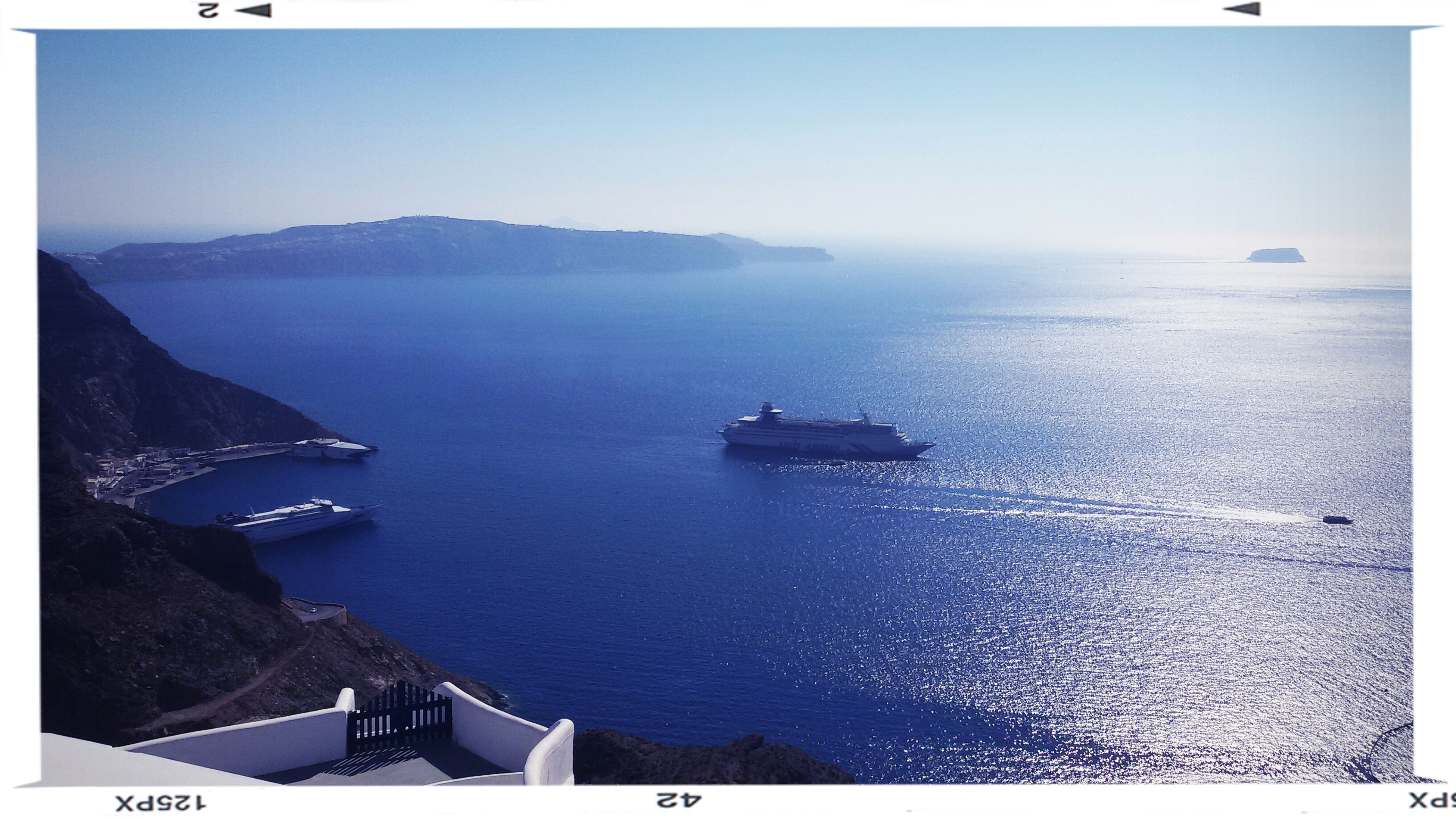 transfer print, sea, water, auto post production filter, nautical vessel, horizon over water, transportation, boat, scenics, clear sky, high angle view, mode of transport, tranquil scene, tranquility, mountain, beauty in nature, nature, coastline, waterfront, blue