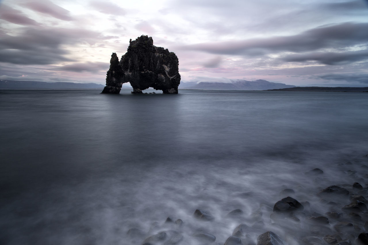 Drinking dragon, exposed rock in Iceland, seashore of the Atlantic ocean. Atlantic Ocean Beach Beauty In Nature Cloud - Sky Coastline; Cyclone; Horizon Over Water Hurricane; Iceland Landscape Long Exposure Nature Nordic Northsea Ocean; Outdoors Rock - Object Sea Seascape; Seashore Sky Sunset Travel Destinations Water Waves