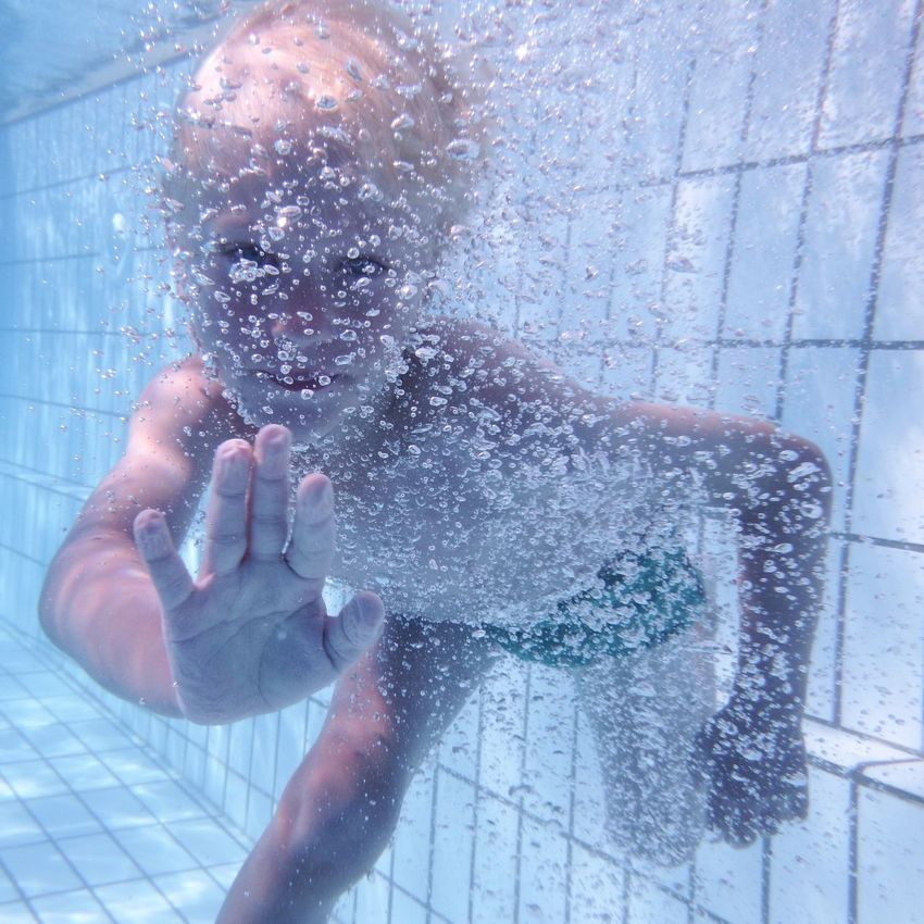 Kid Child Boy Pool Playing In The Water Diving Swimming Bubbles Airbubbles Hand Hand In Front Stop Close-up Close Up One Person EyeView