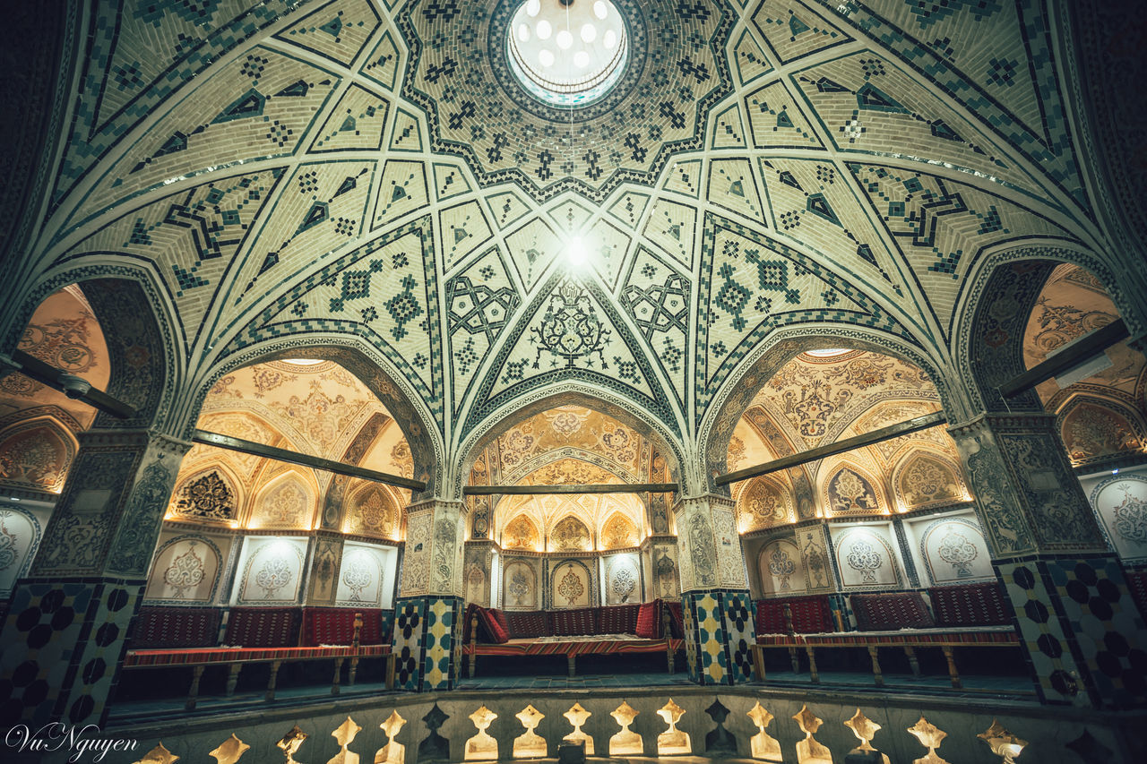 ceiling, architecture, indoors, arch, low angle view, religion, place of worship, fresco, window, built structure, history, travel destinations, dome, no people, illuminated, day