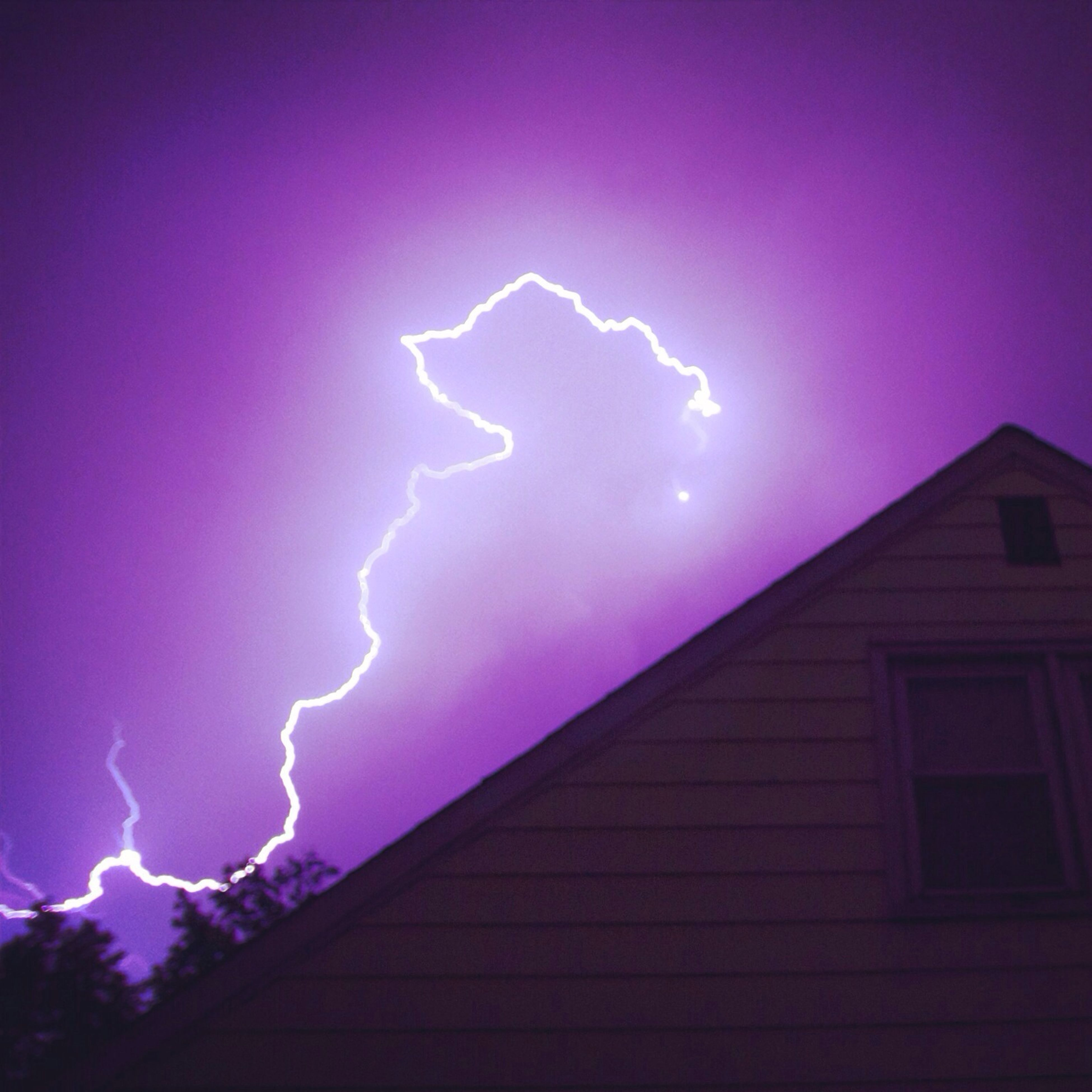 sky, blue, night, illuminated, low angle view, power in nature, lightning, building exterior, thunderstorm, cloud - sky, built structure, architecture, multi colored, copy space, weather, storm, nature, no people, outdoors, purple