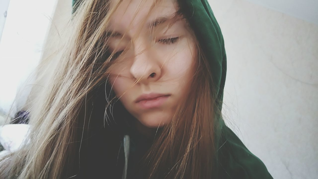 Sadness Young Adult Disappointment Long Hair Window One Person One Young Woman Only Headshot Depression - Sadness Beauty Sulking Adult Young Women One Woman Only Close-up Only Women People Indoors  Frowning Adults Only