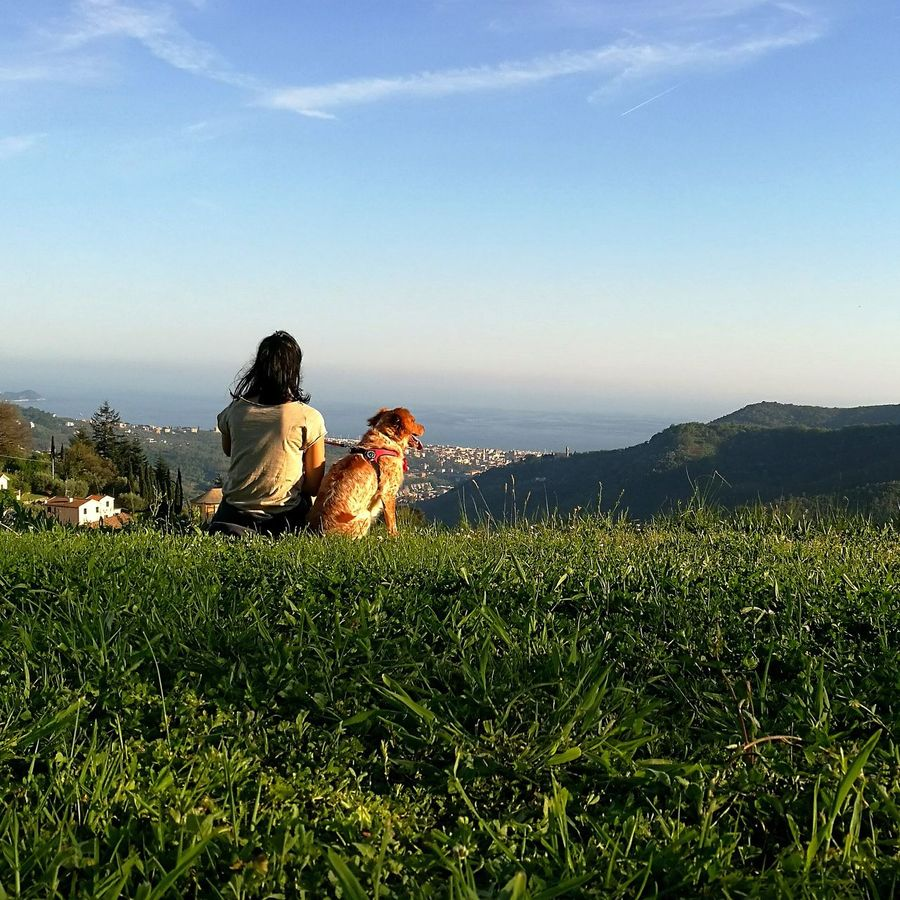 Doglover Dog Green Color Green Blue Sky Blue Girl Girl With Dark Hair Girl With Dog Italy Sea Mare Vista Panorama Free Paradise Grass Sitting Women Pets Outdoors