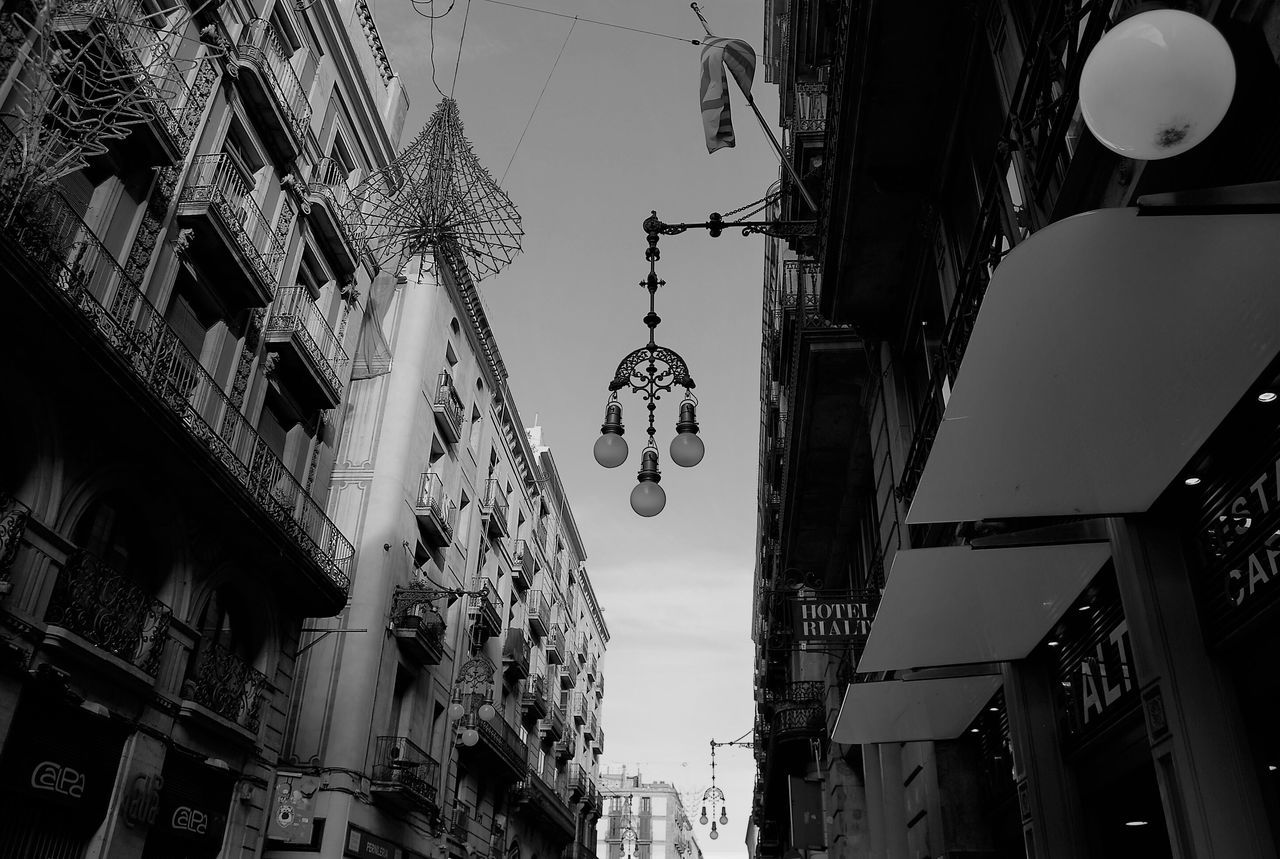 Low Angle View Hanging Built Structure Building Exterior Lighting Equipment Architecture No People City Day Outdoors Blancoynegro Eye4black&white  Blackandwhite Photography Blackandwhite EyeEm Bnw Eye4photography  EyeEm Gallery Bnw Bnw_collection Black And White Barcelona