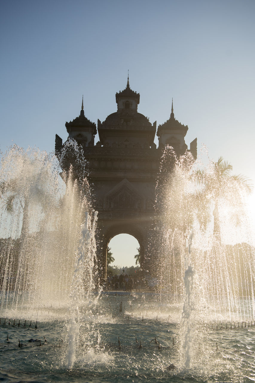 motion, fountain, water, splashing, architecture, outdoors, spraying, clear sky, no people, day, sky, nature