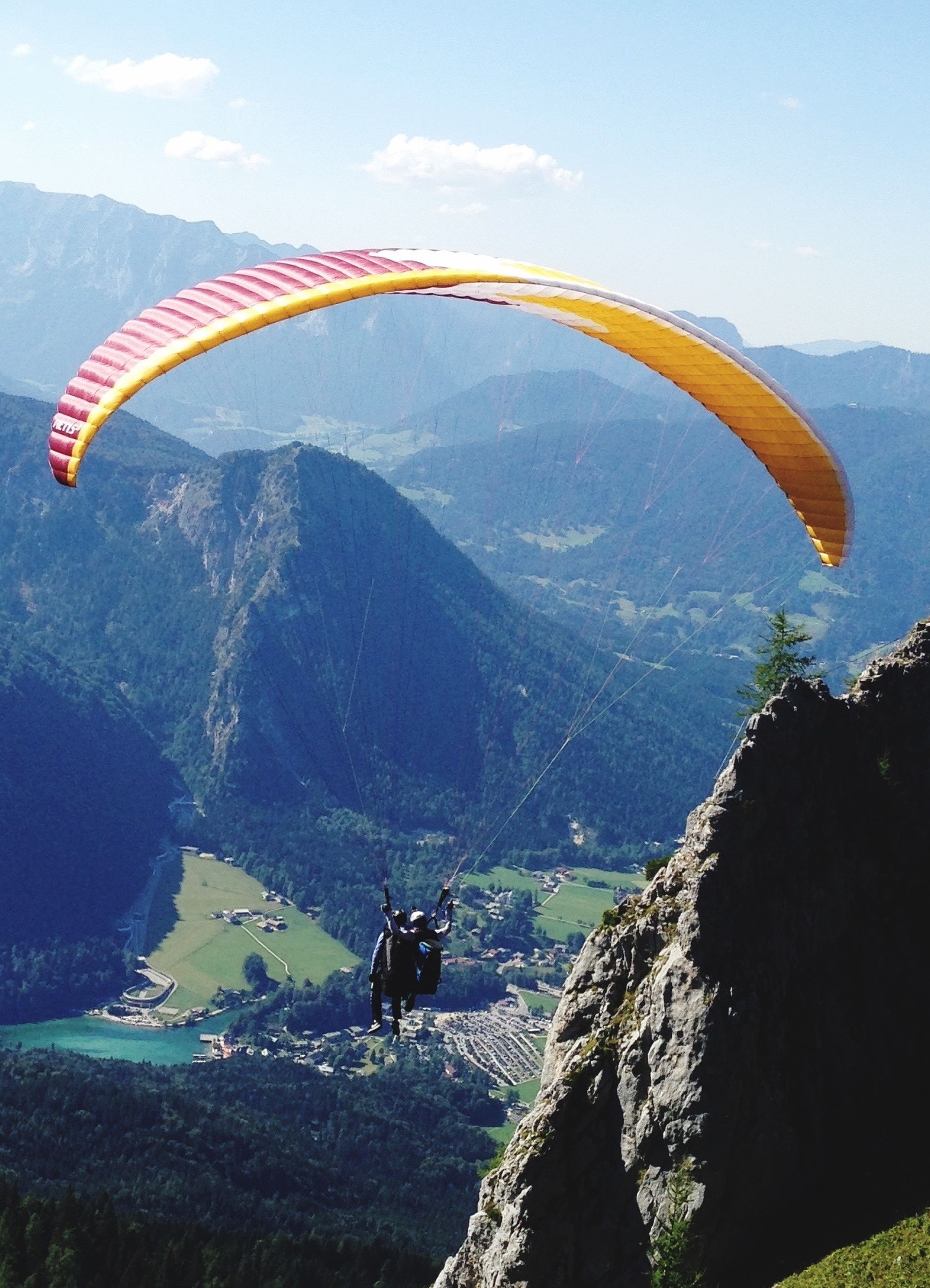 mountain, day, mountain range, nature, adventure, flying, scenics, outdoors, beauty in nature, sky, parachute, transportation, tranquil scene, mid-air, landscape, extreme sports, sunlight, paragliding, sport, real people, men, one person, people