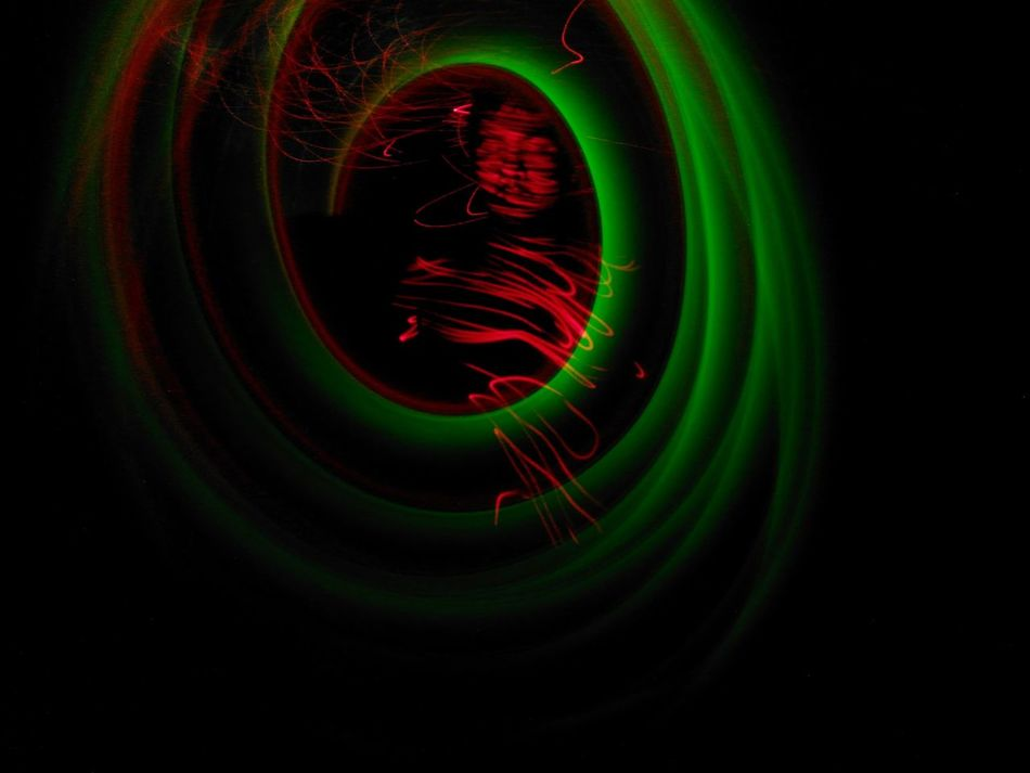 Trapped in a spiral Green Color Black Background Conceptual Self Portrait Multi Colored Close-up Light Painting Photography. Art One Person Long Exposure Light Trail Selfportrait Indoors  Abstract Laser Art Is Everywhere