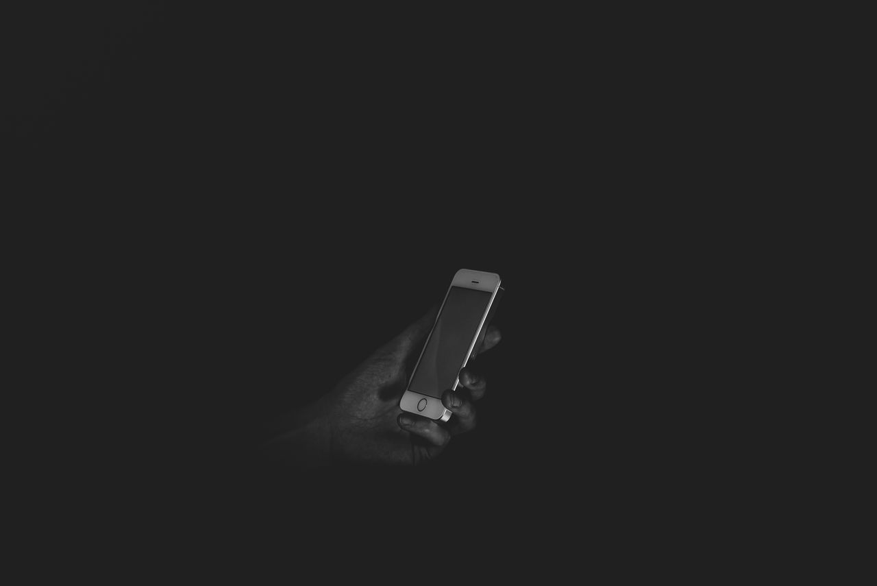 Find me in the dark Darkness Loneliness Black Background Close-up Darkness And Light Day Human Body Part Human Hand IPhone Modern Communication People Single Object Studio Shot Technology