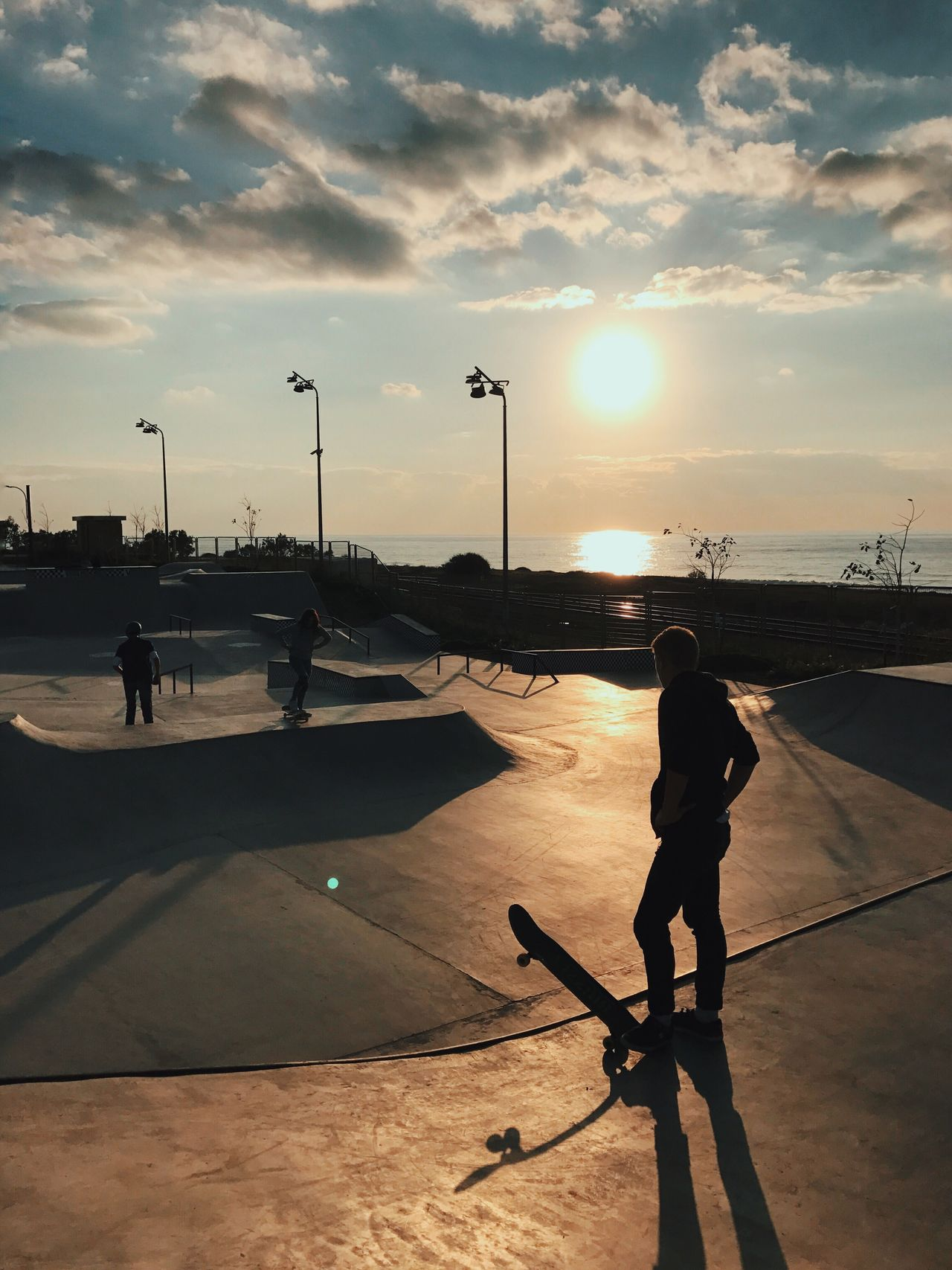 Real People Sunset Sport Sunlight Leisure Activity Sky Full Length Shadow Lifestyles Silhouette One Person Outdoors Cloud - Sky Skateboard Park Nature Men Childhood Extreme Sports Day People Shotoniphone7plus מייאייפון7 IPhone7Plus מייסקייט The Street Photographer - 2017 EyeEm Awards
