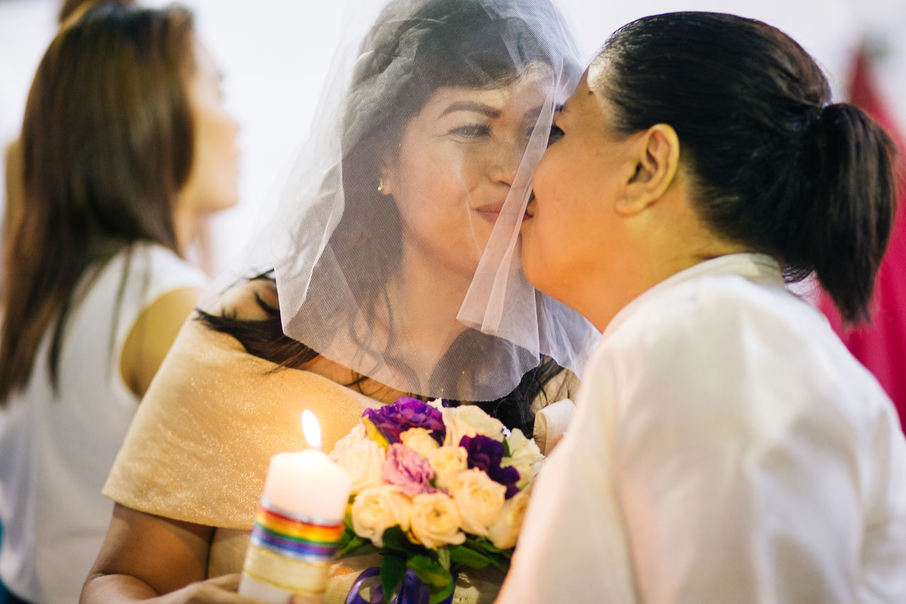 After being together for 2 years, Marilyn (43) and Dhey (42) wanted to get married and start their own family. Marily's friend played the matchmaker by introducing them to each other 3 years ago. They're one of 8 couples who participate in the LGBT Mass Wedding in Quezon City, Manila on Sunday, despite that the same-sex marriage isn't legally recognized in Philippines yet. Eyeem Philippines lesbiancouple lesbianwedding lgbt lgbt wedding LGBTQ Rights Love love is love loveislove Photojournalism Showcase June twobrides Wedding