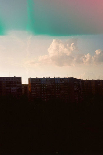 Analogue Photography Aurora Borealis Block Of Flats Building Exterior Cityscape Clouds And Sky Lights And Shadows Moody Sky No People Poland Residential District Storm Cloud This Is Perfect For A Poster