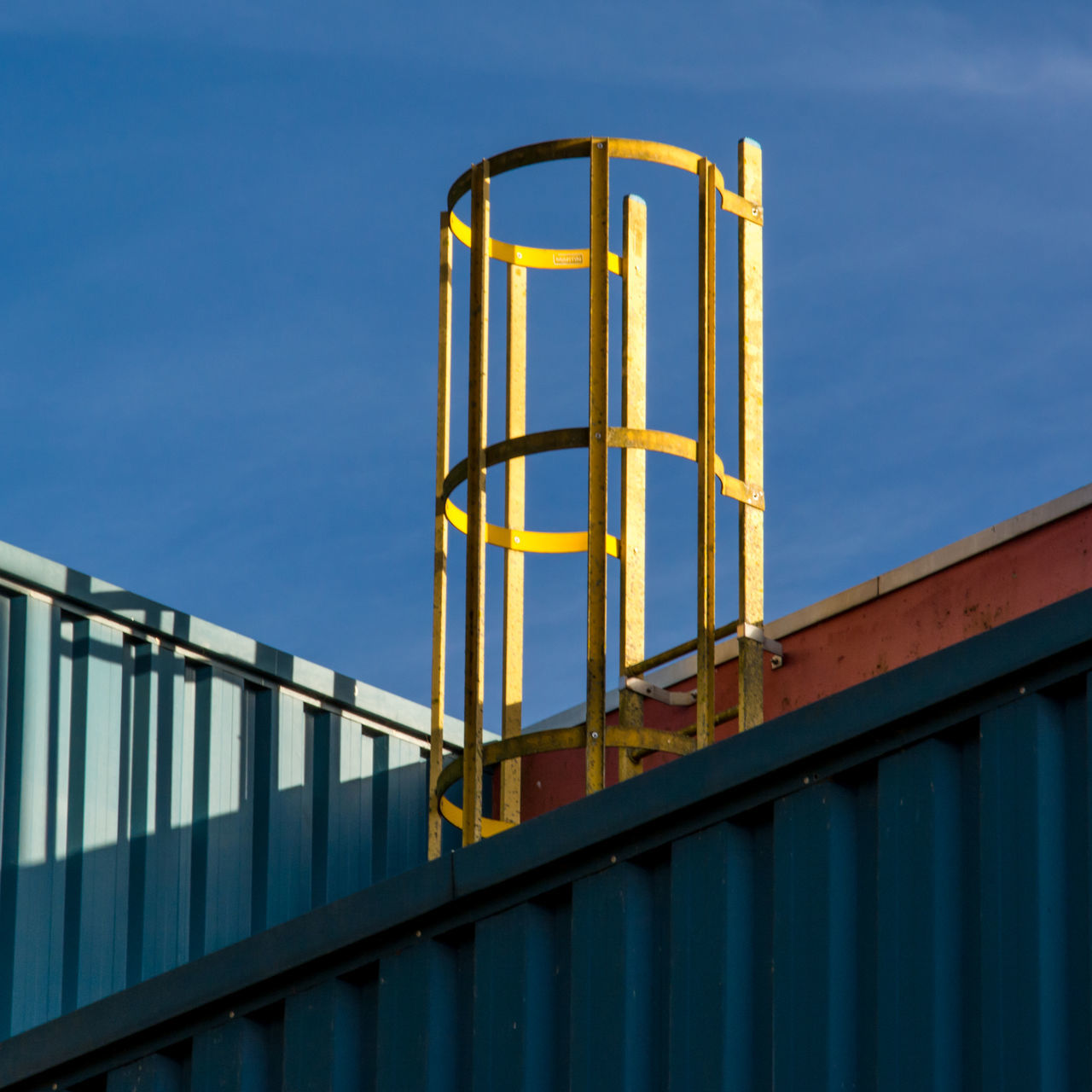 Strictly yellow on blue Architectural Detail Architecture Architecture_collection Built Structure Day Low Angle View Metal No People Outdoors Shadows Sky Urban Geometry Urban Skyline Urbanphotography The City Light Minimalist Architecture Minimalz Premium Collection
