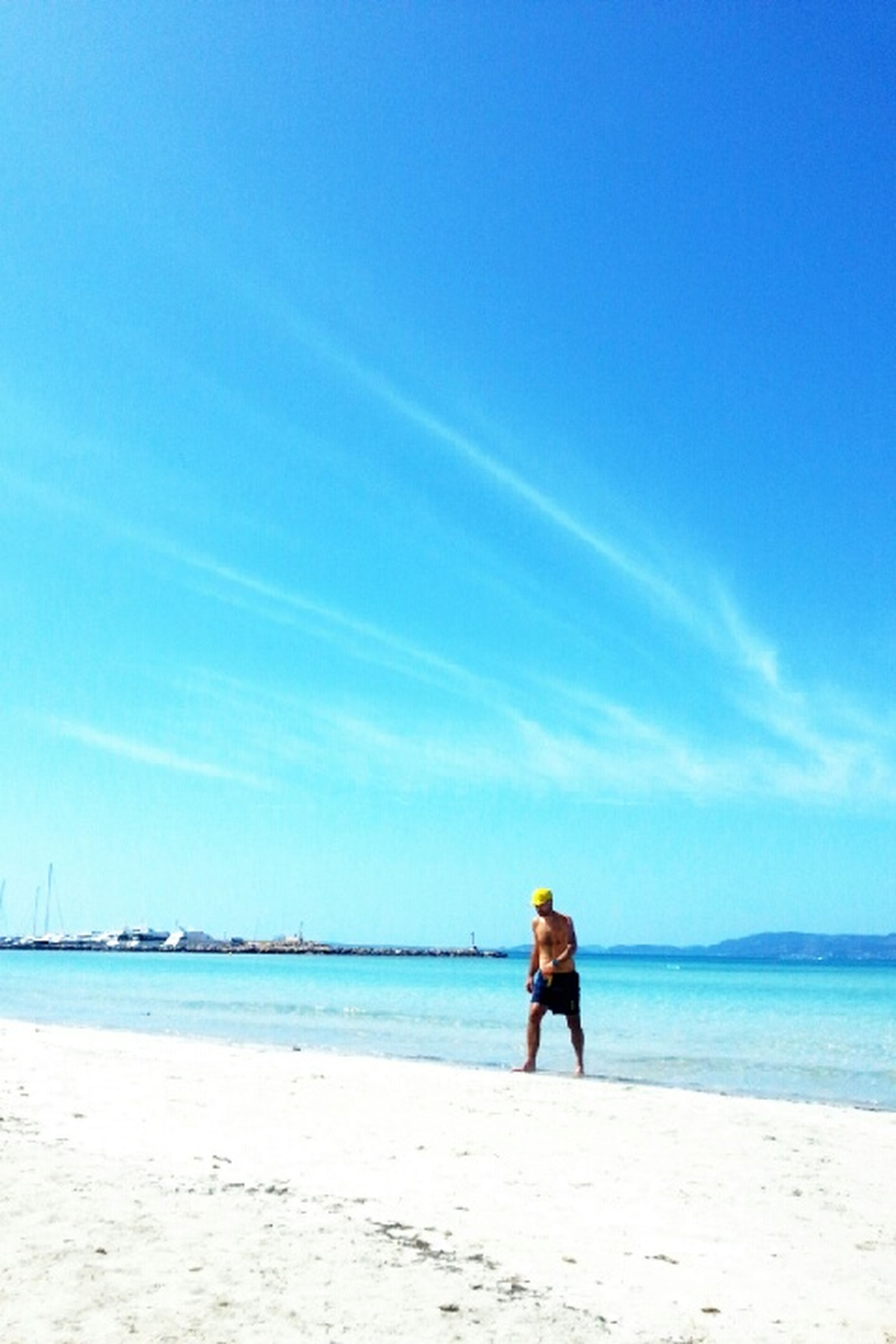sea, beach, blue, water, rear view, shore, sky, sand, tranquility, lifestyles, tranquil scene, leisure activity, full length, scenics, standing, beauty in nature, nature, vacations