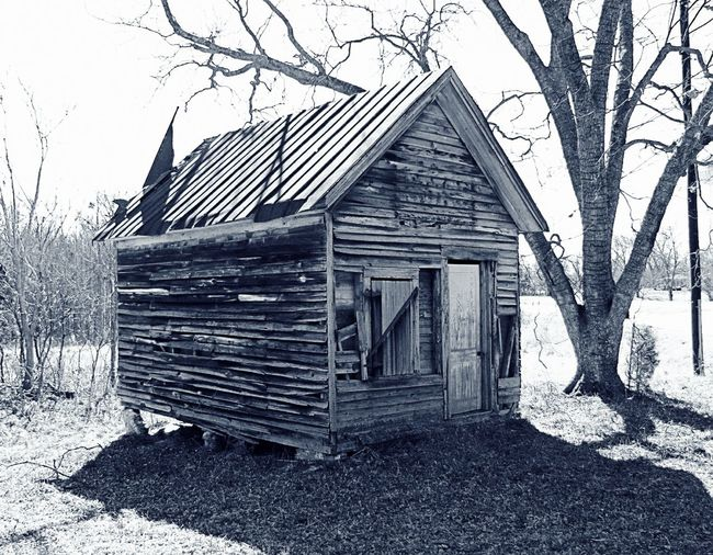 Architecture Bare Tree Blackandwhite Photography Branch Building Exterior Built Structure Clear Sky Day Detail Entrance Façade Farm House In Front Of No People Obsolete Old Outdoors Rural Scene Shack Sky Tranquility Tree Weathered