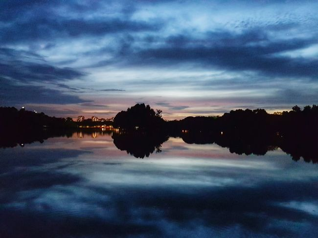 Reflection Water Sky Reflection Lake Travel Sunset Nature Cloud - Sky Landscape Tranquility Tree Lake Horizontal No People Outdoors Astronomy Night Space