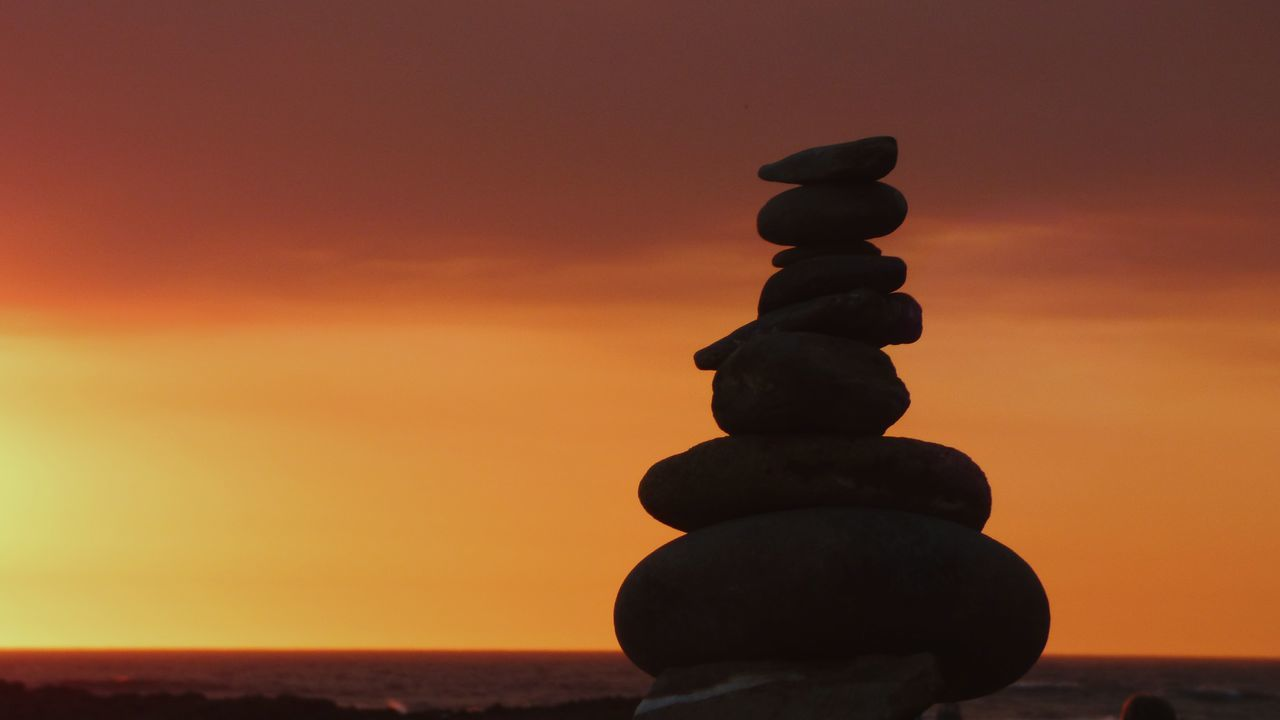 EyeEm Selects Praia Do Farol Milfontes Sunset Balance In A Row Stack No People Silhouette Stability Outdoors Zen Rocks Zen Rock On Beach Zen Rock At Sunset Nature Tranquility Sky Orange Sky Orange Color Sunset Silhouettes Sunset_collection Close-up
