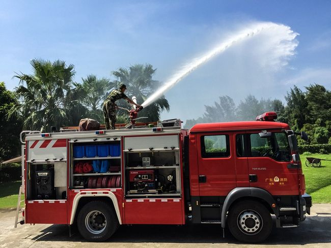 Transportation Mode Of Transport Land Vehicle Tree Sky Stationary Outdoors Blue Day Transport Green Color Fire Truck Fire Department Fire Engine Fire Engine Truck Red Chinese China Zhuhai Unrecognizable Person