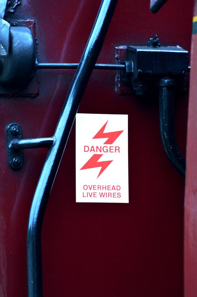 Black On Red Churnet Valley Railway Close-up Danger Danger Sign Day Lightning Bolt Mode Of Transport No People Part Of Railway Carriage Red