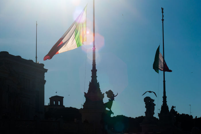 Italia Architecture Bandiera Building Exterior Built Structure Controluce Day Flag History Low Angle View No People Outdoors Sky Sole Statue Sunlight