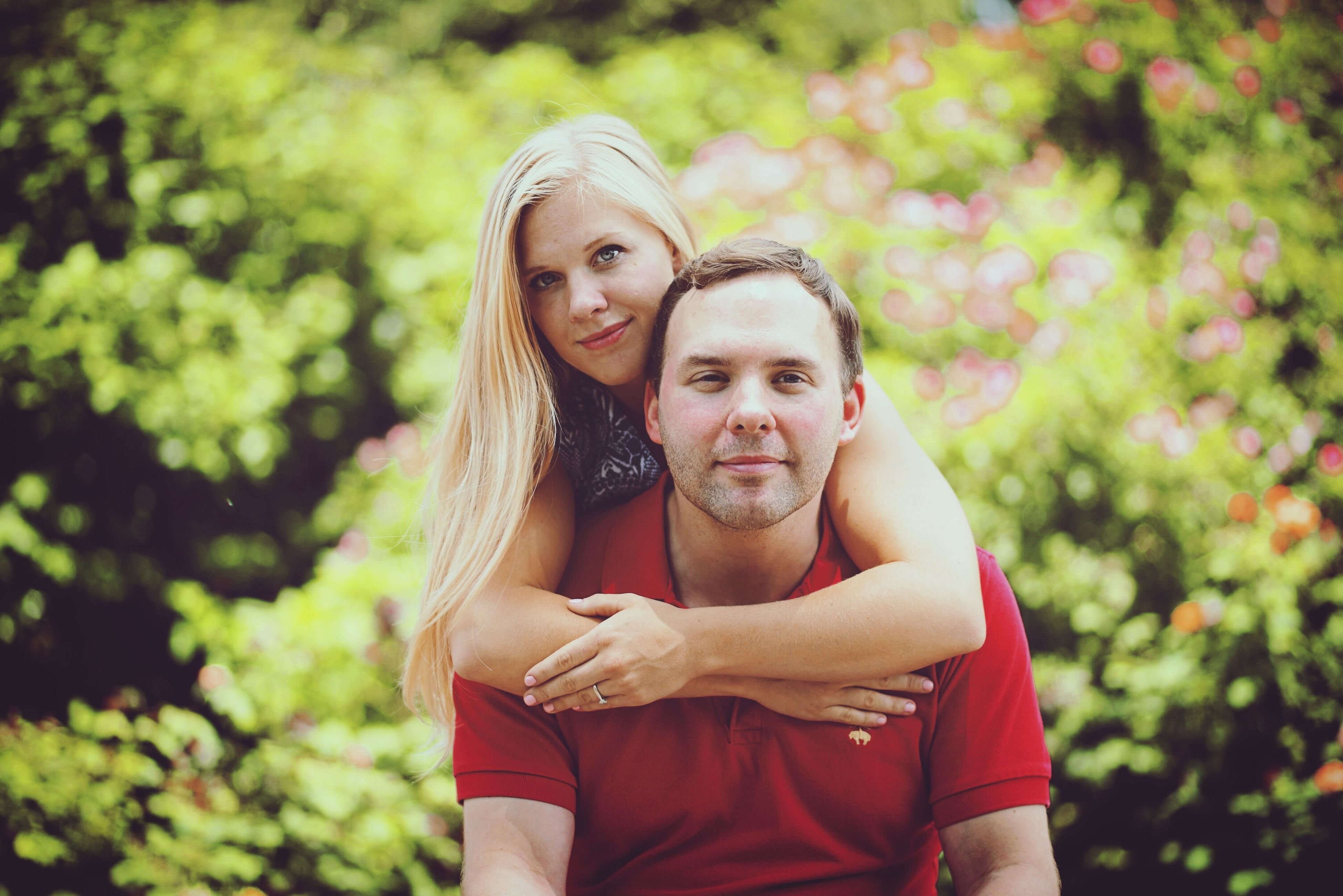 two people, portrait, happiness, embracing, looking at camera, love, park - man made space, smiling, togetherness, heterosexual couple, beautiful people, social issues, young adult, women, adult, females, blond hair, fun, lifestyles, young women, men, care, green color, outdoors, bonding, beauty, friendship, people, cheerful, nature, adults only, day