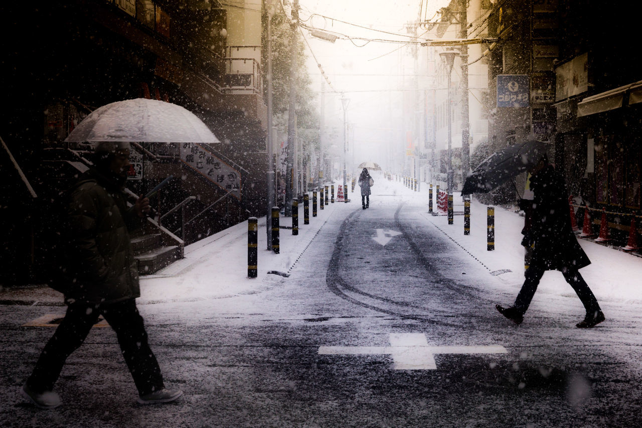 snow trio City Life Cold Cold Days Cold Temperature Cold Winter ❄⛄ Cross Crossing Interesting People Road Snow Snow ❄ Snowing Street Street Photography Streetphotography Three Tower Town TOWNSCAPE Trinity Trio Umbrella Weather Wet