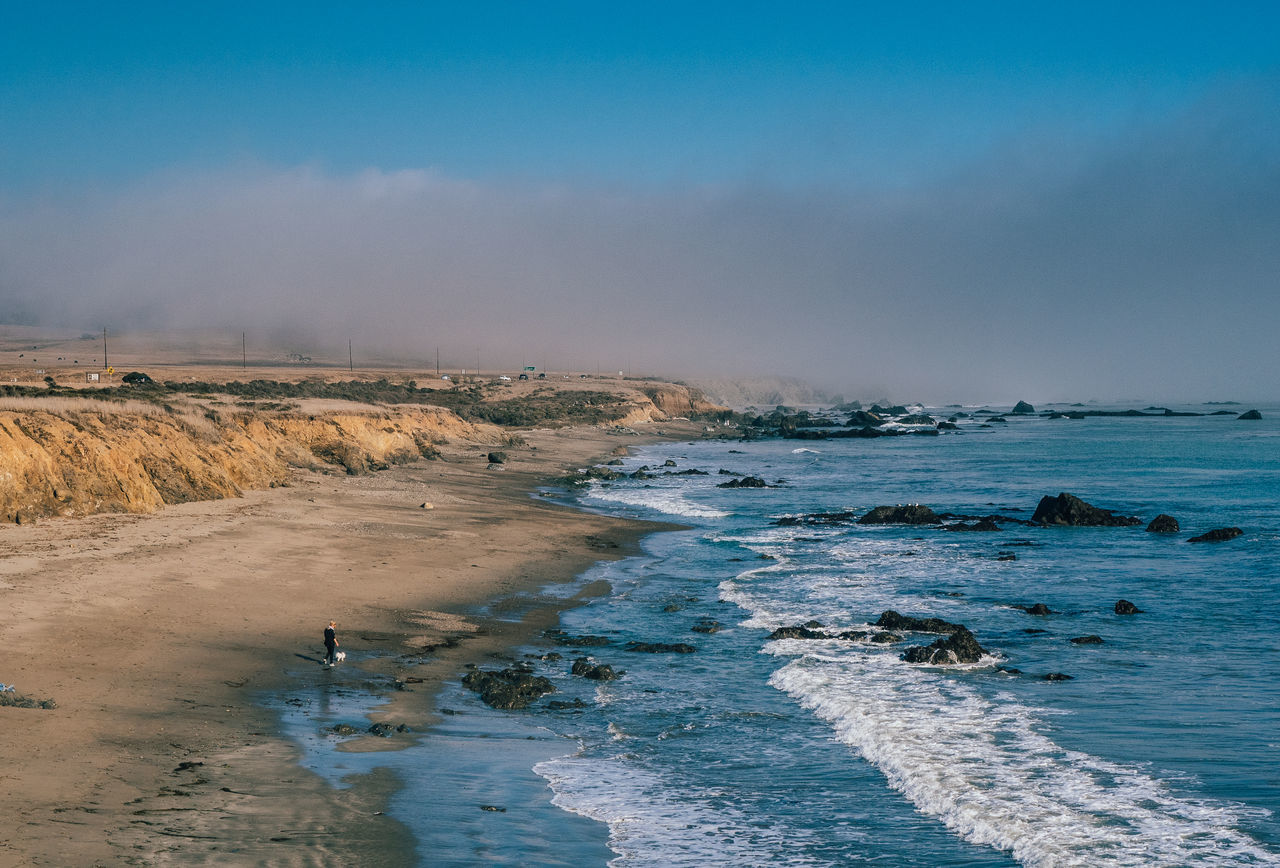 By the Sea Alone Beach Beauty In Nature Big Sur California Cloudy Day Fog Nature No People Outdoors San Simeon San Simeon, Ca Sand Scenics Sea Sky Tranquility Travel Travel Destinations USA Water Wave Waves