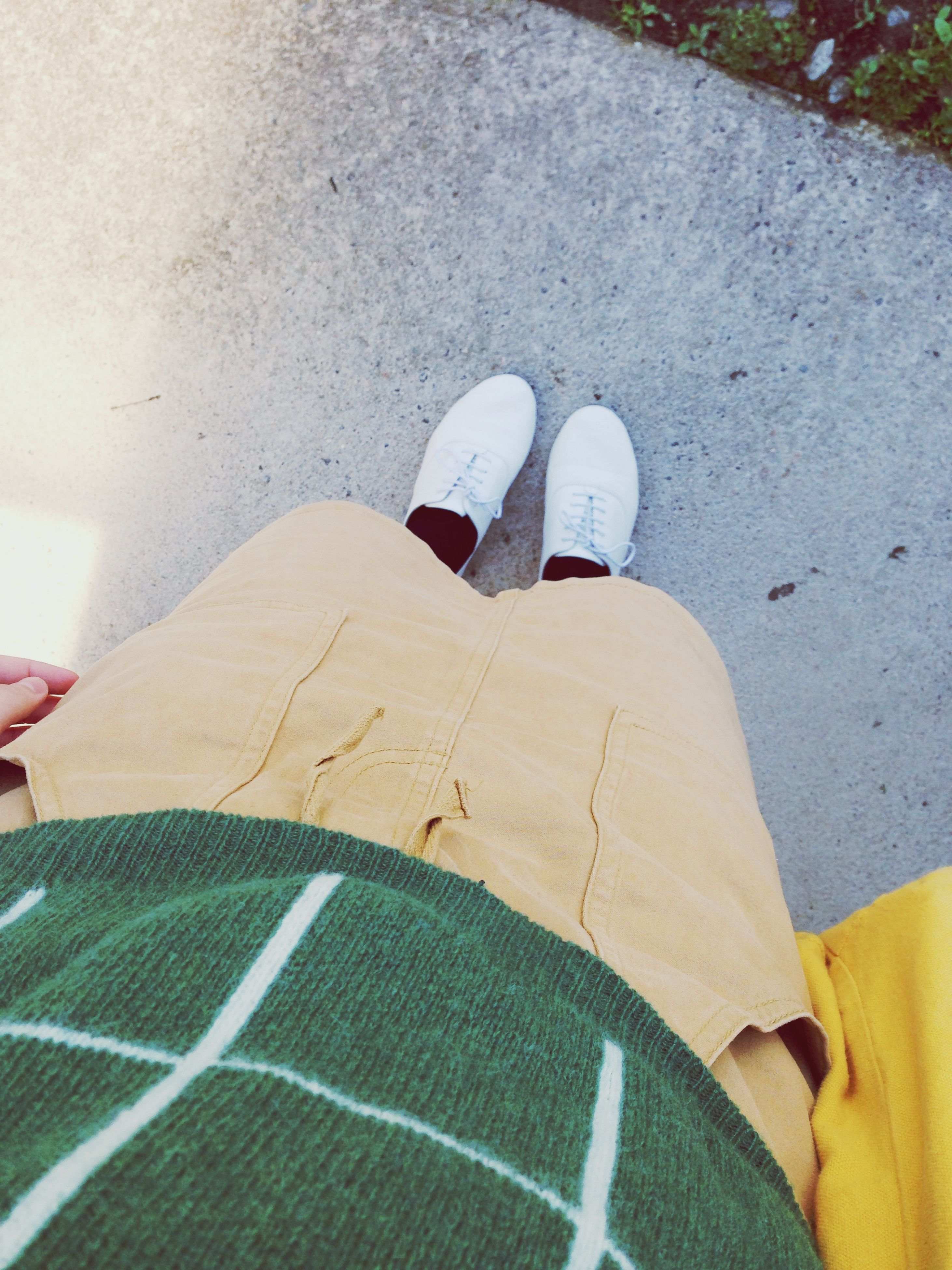 lifestyles, low section, person, shoe, leisure activity, personal perspective, high angle view, men, footwear, casual clothing, standing, jeans, street, sunlight, day, human foot, outdoors