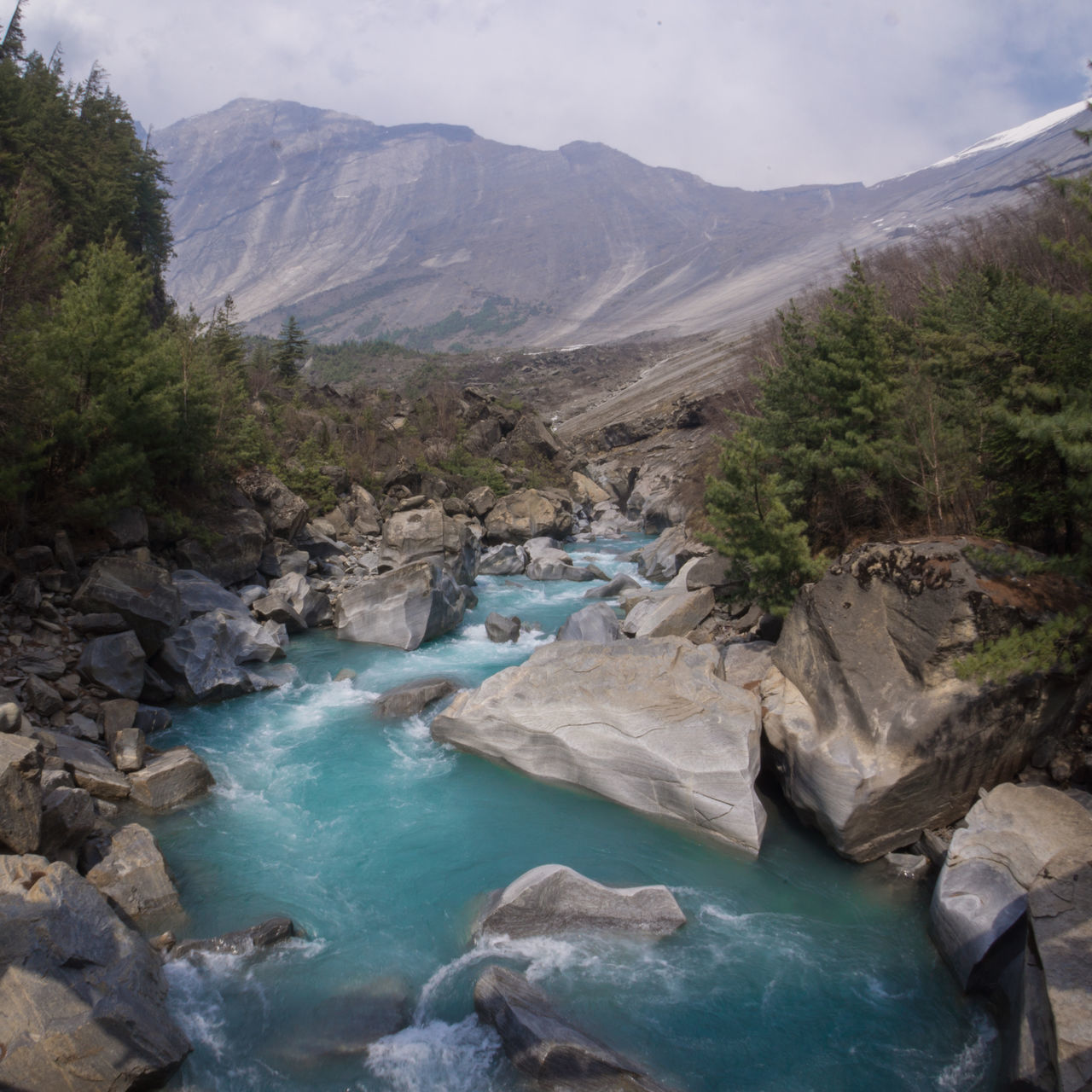 Hiking the Annapurna Circuit Beauty In Nature Day Landscape Mountain Nature No People Outdoors River Scenery Scenics Sky Tranquility Water The Great Outdoors - 2017 EyeEm Awards