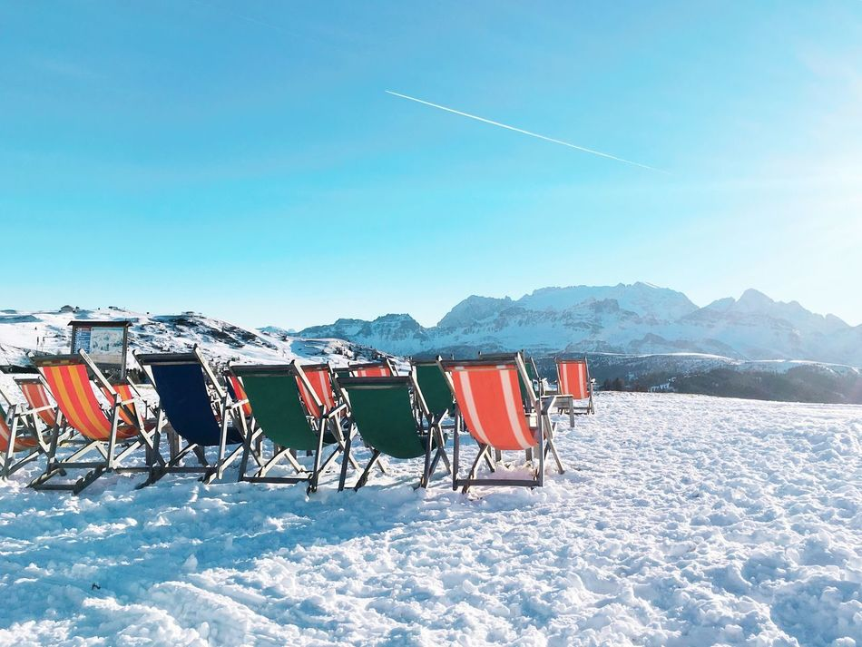 Scenics Snow Sun Sunchair Sun Chairs On Rocks Blue Sky Travel Winter Wintervacation Relaxing Alpine Dolomites, Italy Copy Space Cold Temperature Mountain Mountain View Vacation Time Chairs Beauty In Nature Nature No People Day Outdoors Landscape Sky