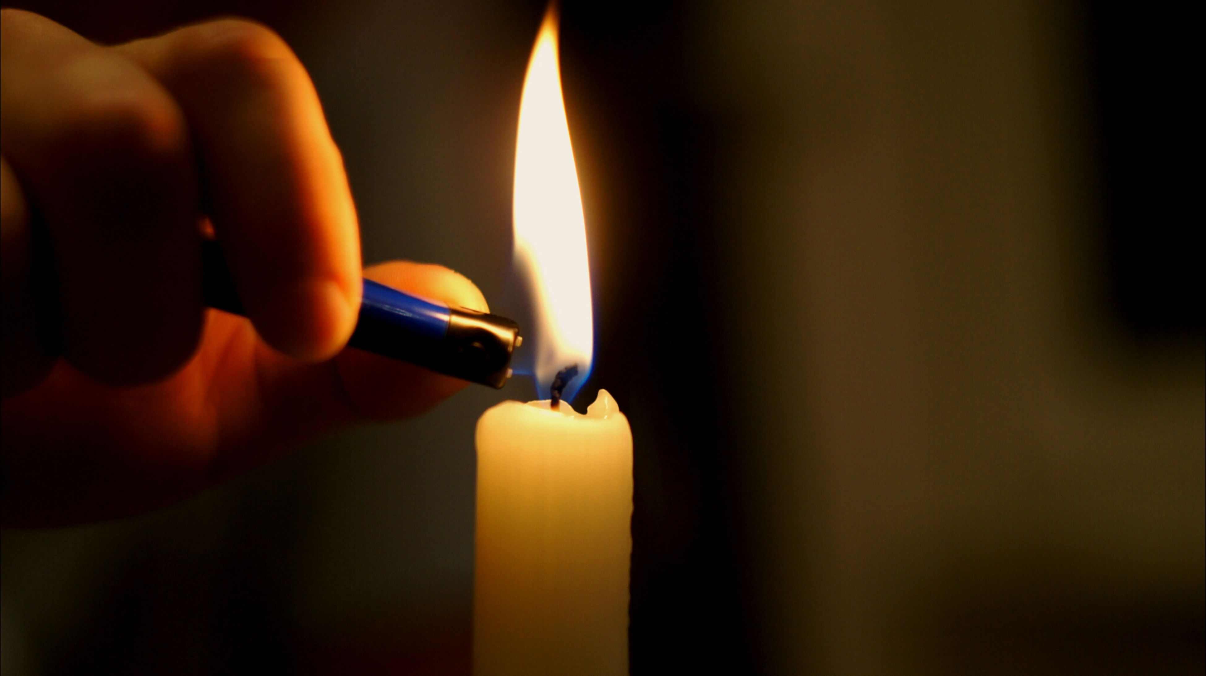 indoors, person, part of, close-up, flame, burning, heat - temperature, cropped, holding, fire - natural phenomenon, glowing, human finger, focus on foreground, illuminated, candle, selective focus, orange color
