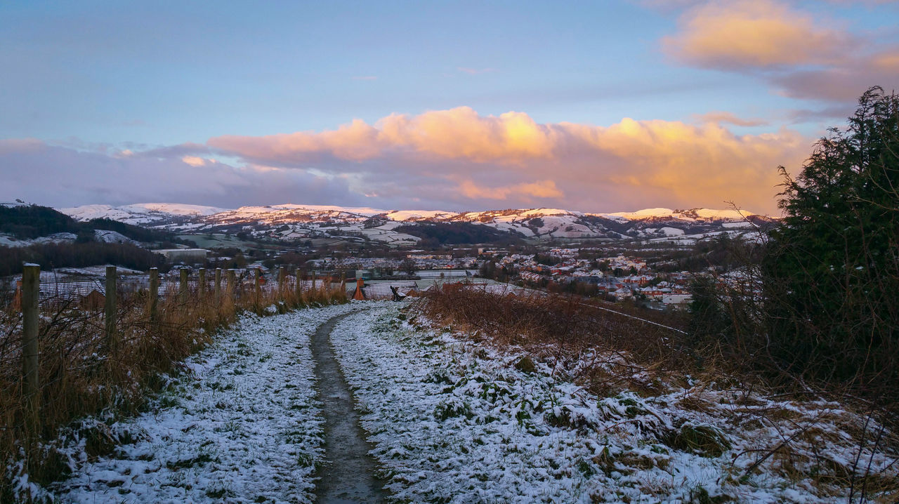 ... First Snow on a Last Day Of Winter Winter Landscape Sunset Tree Snow Cloud - Sky Sky Nature Scenics Beauty In Nature Agriculture Outdoors No People Day Dawn Newtown Powys Wales Hills Pink Town Morning Path Footpath