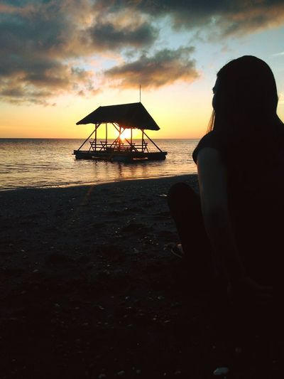 Peace and Serenity. Beach Sea Rear View Silhouette Sunset Adult Sky Adults Only One Woman Only People Relaxation Vacations One Person Outdoors Sand Tranquility Only Women Women Water Horizon Over Water
