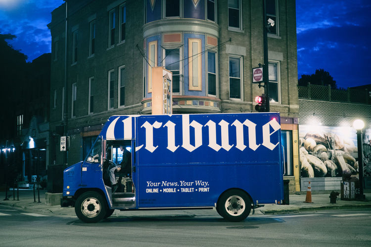 newpaper truck delivering in the early morning hours Analogue Chicago Driver Blue Blue Sky City Communication Dawn Delivering Early Morning Journalism News Newspaper Offline Offline News Outdoors Paper Paper Boy Slow Slow News Street Scene Text Transportation Tribune Truck