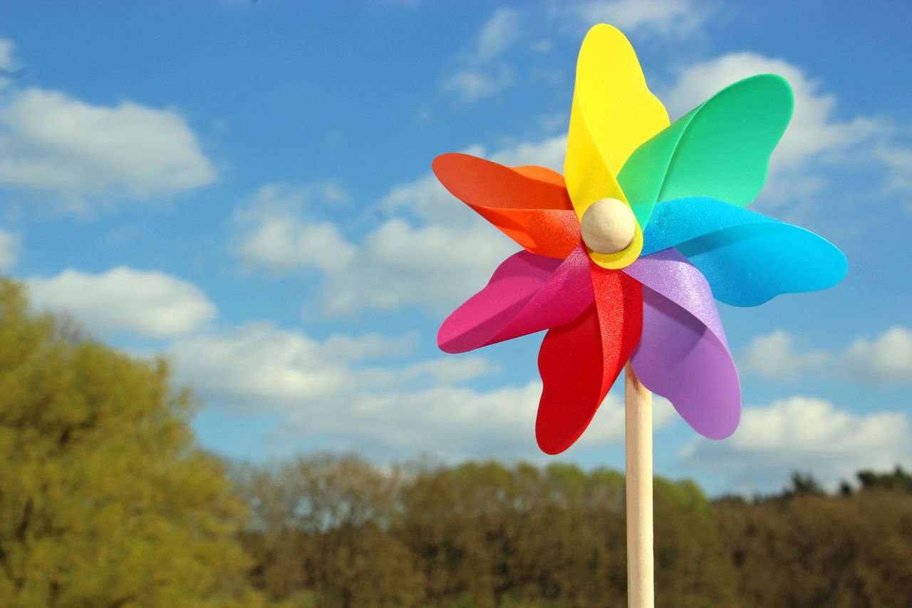 Colorful pin wheel, sky with clouds, trees Sky Cloud - Sky Close-up Pin Wheel No People Multi Colored Day Nature Outdoors Springtime Freedom Happiness Joy Cheerful Playful Spring Toy Sunshine Childhood Nature Summer Color Desktop background Copy Space