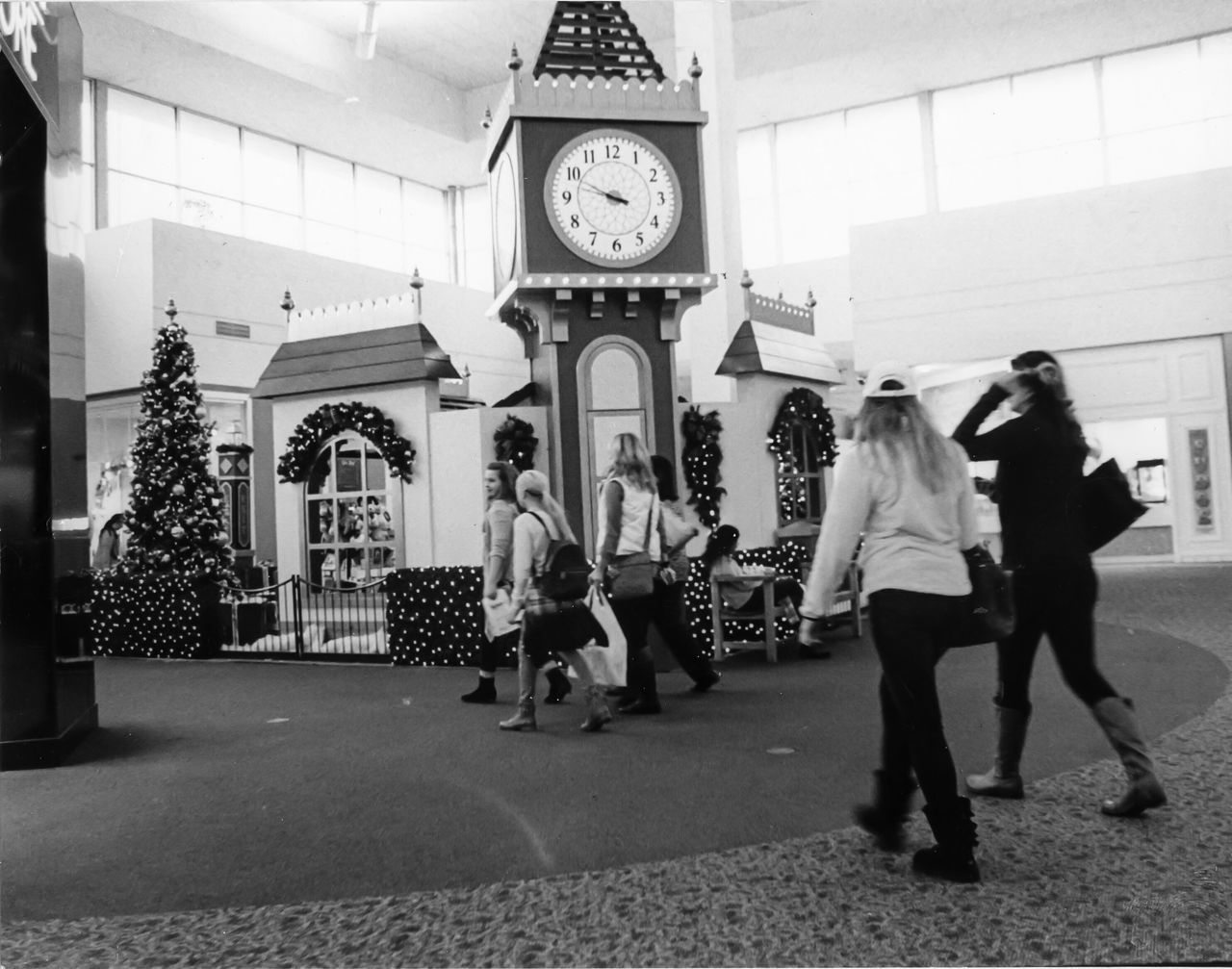 Walking Away Series - Black Friday Clock Time Full Length Adults Only Indoors  Women People Clock Face Day Mall Black & White B&w Street Photography Leisure Activity Real People Hanging Out Taking Photos Ieica_r7 Filmisnotdead Film Camera Illfordhp5 Film Photography Filmcamera Film