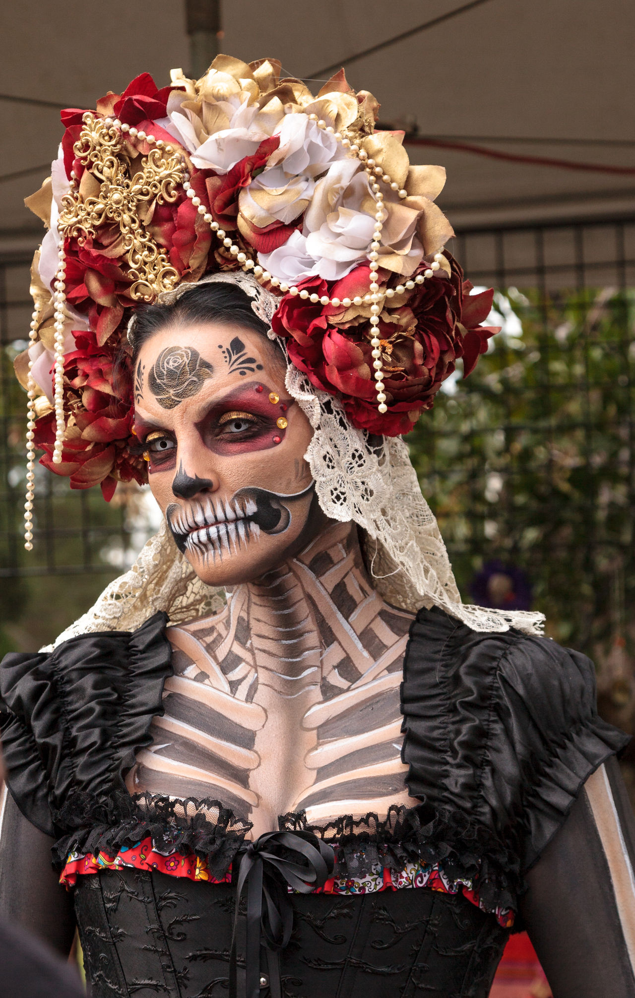 Los Angeles, CA, USA - October 29, 2016: Skeleton woman performer at Dia de los Muertos, Day of the dead, in Los Angeles at the Hollywood Forever Cemetery grounds. Editorial use only. Adult Adults Only All Saints Day Butterfly Day Day Of The Dead Dia De Los Muertos Face Paint Goth Gothic Halloween Headdress Outdoors People Performer  Skelleton Steam Punk Woman